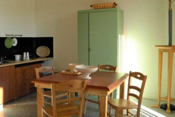 Zona pranzo appartamento Pistacchio